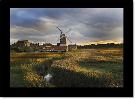 Reedbed and Cley Mill at Cley North Norfolk on a stormy evening in October