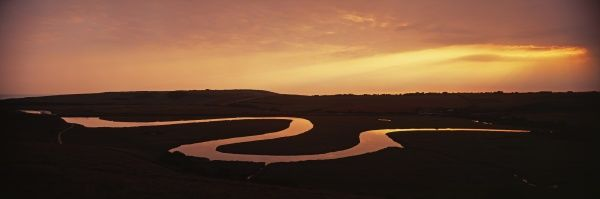 Cuckmere River, showing oxbow lakes at dusk, Cuckmere Haven, Sussex, summer