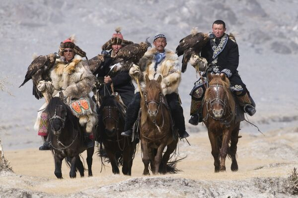 Eagle hunters on route to the Eagle Hunters festival near Ulgii in western Mongolia October